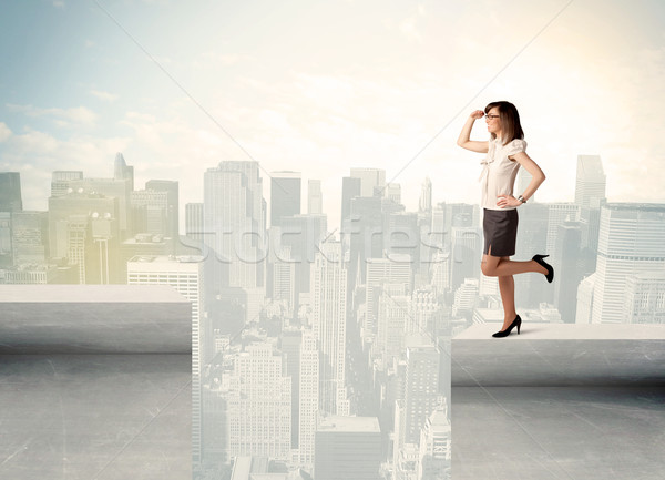 Businesswoman standing on the edge of rooftop Stock photo © ra2studio