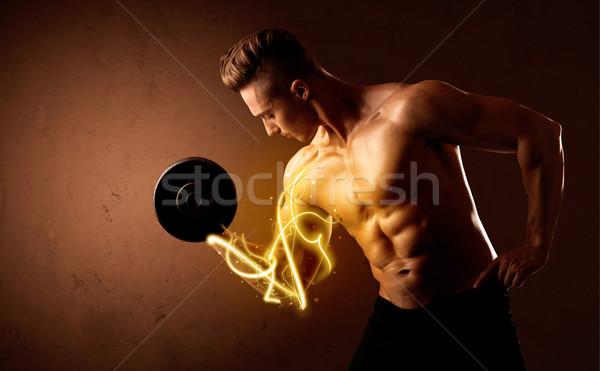 Corps musclé constructeur poids énergie lumières Photo stock © ra2studio