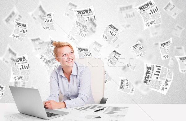Stock photo: Business woman at desk with stock market newspapers