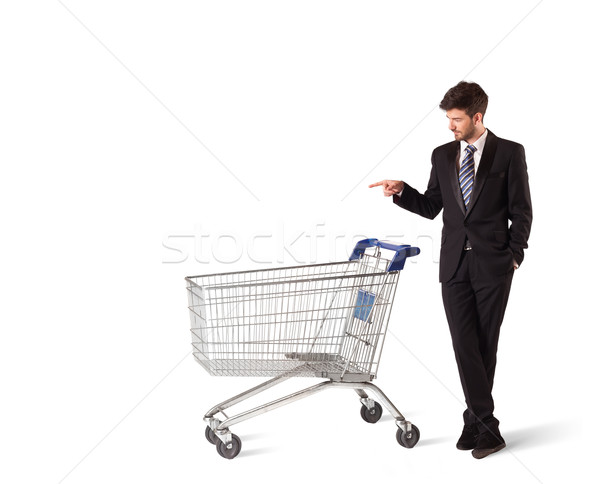 Zakenman winkelwagen voortvarend geïsoleerd pak winkel Stockfoto © ra2studio