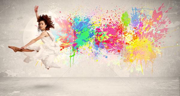 Felice adolescente jumping colorato inchiostro splatter Foto d'archivio © ra2studio