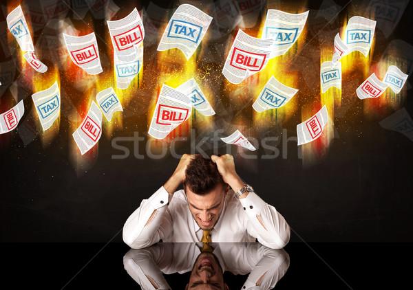 Bunalımlı işadamı oturma yanan vergi fatura Stok fotoğraf © ra2studio
