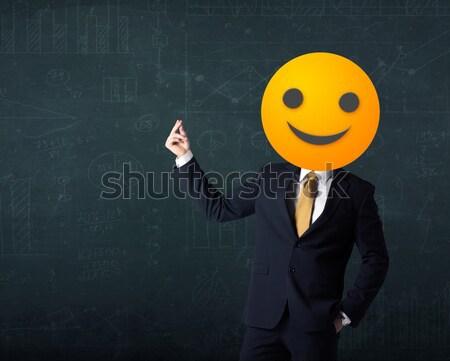 businessman wears yellow smiley face Stock photo © ra2studio