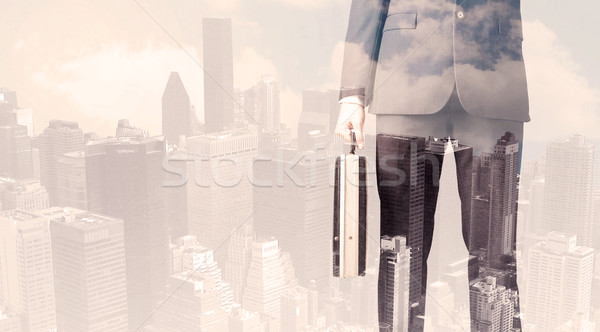 Handsome business man with overlay cityscape Stock photo © ra2studio