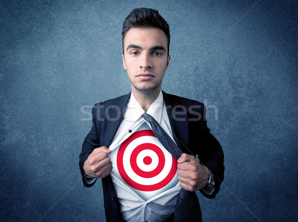 Businessman tearing shirt with target sign on his chest Stock photo © ra2studio