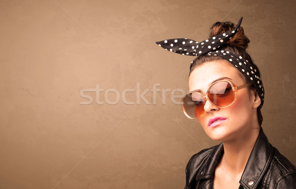 Portrait of a young pretty woman with sunglasses and copyspace Stock photo © ra2studio