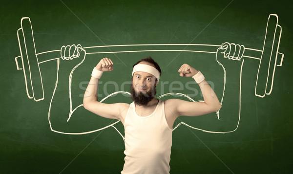 Fiatalember emel súly szakáll szemüveg pózol Stock fotó © ra2studio