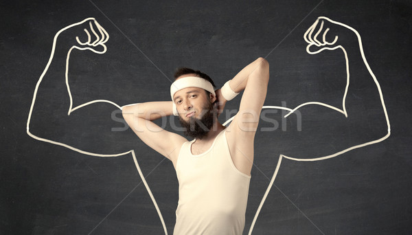 Young weak man with drawn muscles Stock photo © ra2studio