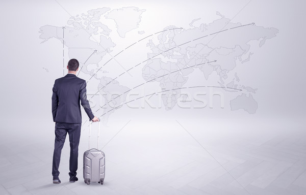 Businessman planning his trip over the world Stock photo © ra2studio