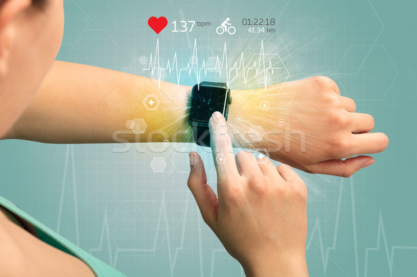 Cycle and smartwatch concept. Stock photo © ra2studio