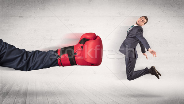 Arm with boxing gloves hits office worker concept Stock photo © ra2studio