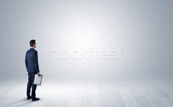 Man with object in his hand in an empty space Stock photo © ra2studio