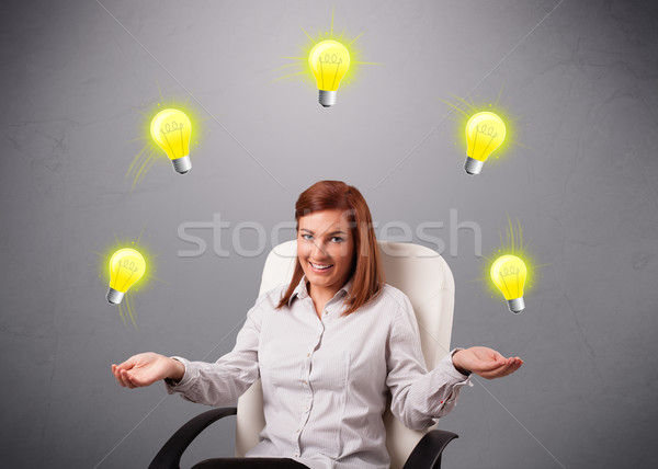 young lady sitting and juggling with light bulbs Stock photo © ra2studio