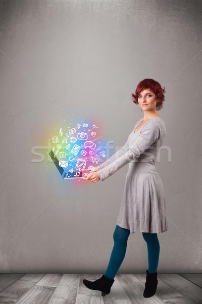 Gyönyörű fiatal nő tart notebook színes kézzel rajzolt Stock fotó © ra2studio