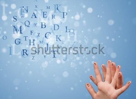 Felice dita guardando miscela bokeh Foto d'archivio © ra2studio