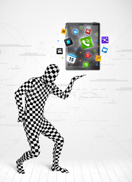 man in full body suit holdig tablet pc Stock photo © ra2studio