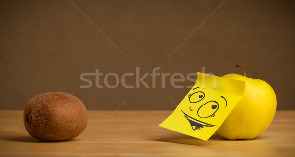 Apple with post-it note looking curiously at kiwi Stock photo © ra2studio