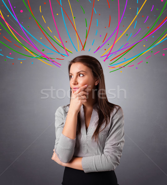 Young girl thinking with colorful abstract lines overhead Stock photo © ra2studio