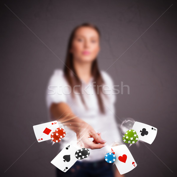 Young woman playing with poker cards and chips  Stock photo © ra2studio
