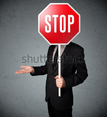 üzletember tart stoptábla áll fej kéz Stock fotó © ra2studio
