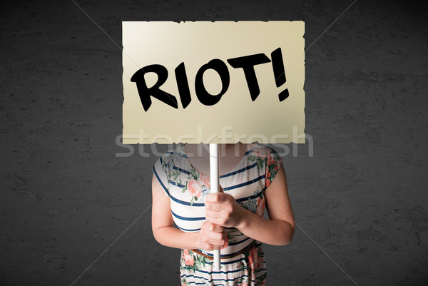 Jeune femme protestation signe démonstration bord Photo stock © ra2studio