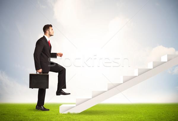 Homme d'affaires escalade up blanche escalier nature Photo stock © ra2studio