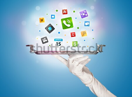 Waiter hand holding tray with icons Stock photo © ra2studio