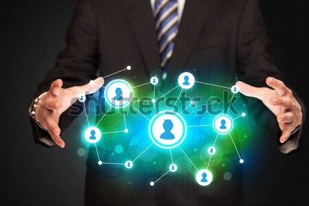 Modern businessman touching future technology social network but Stock photo © ra2studio