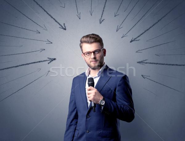 üzletember tart mikrofon beszél nyilak mutat Stock fotó © ra2studio