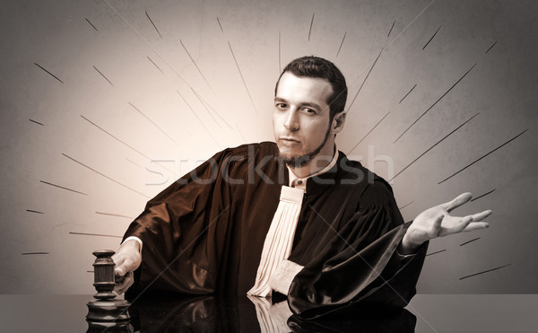Oldscool young judge in gown deciding Stock photo © ra2studio