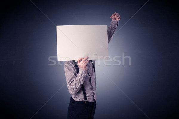 Businessman holding blank paper Stock photo © ra2studio