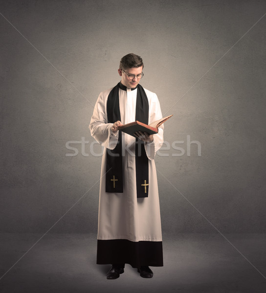 priest in giving his blessing Stock photo © ra2studio