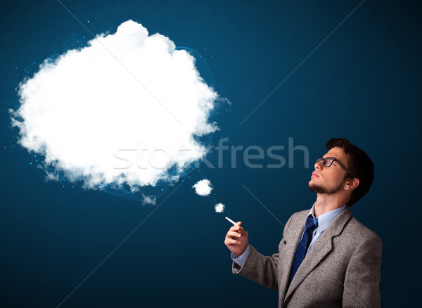 Young man smoking unhealthy cigarette with dense smoke Stock photo © ra2studio