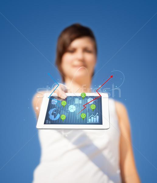 Młodych business woman patrząc nowoczesne tabletka streszczenie Zdjęcia stock © ra2studio