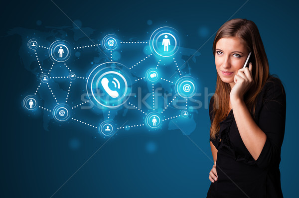 Pretty girl making phone call with social network icons Stock photo © ra2studio