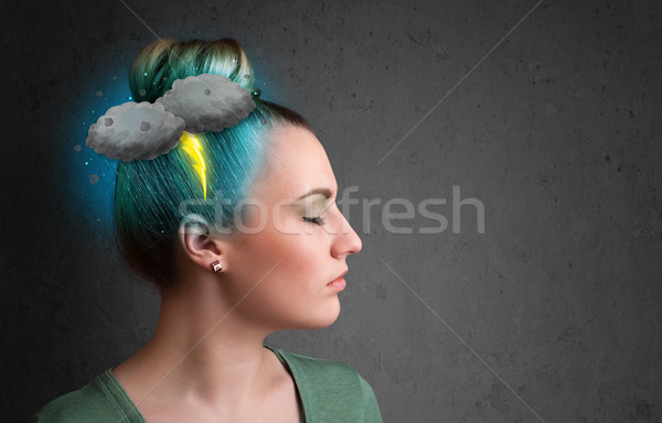 Young girl with thunderstorm lightning headache  Stock photo © ra2studio