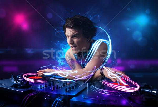 Diskjokey oynama müzik ışık efektleri ışıklar genç Stok fotoğraf © ra2studio