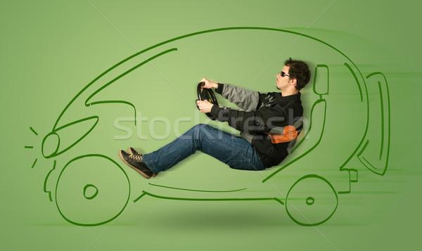Man drives an eco friendy electric hand drawn car  Stock photo © ra2studio