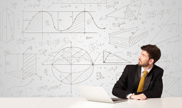 Businessman with business calculations background Stock photo © ra2studio