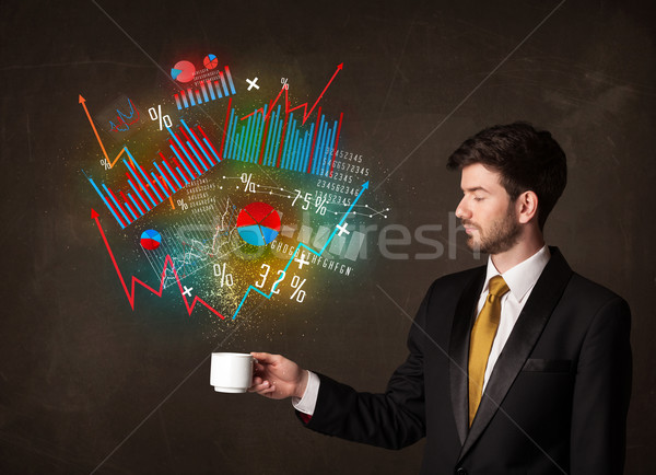Affaires blanche tasse diagrammes graphiques Photo stock © ra2studio