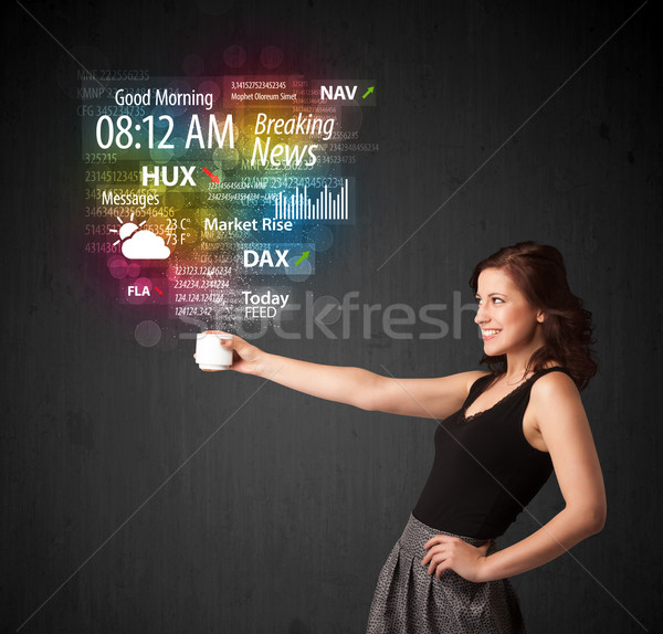 Businesswoman holding a white cup with daily news and informatio Stock photo © ra2studio