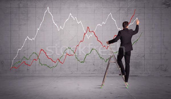 male on ladder drawing chart lines Stock photo © ra2studio