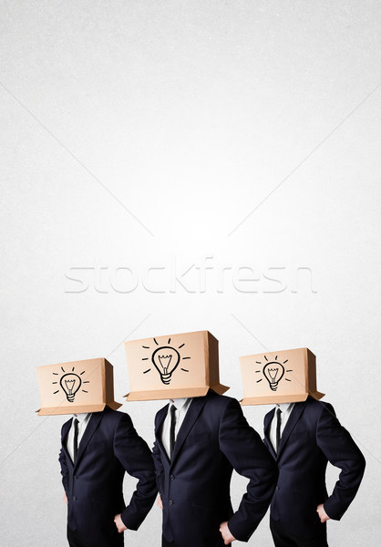 Handsome men in suit gesturing with drawn signs and symbols on b Stock photo © ra2studio