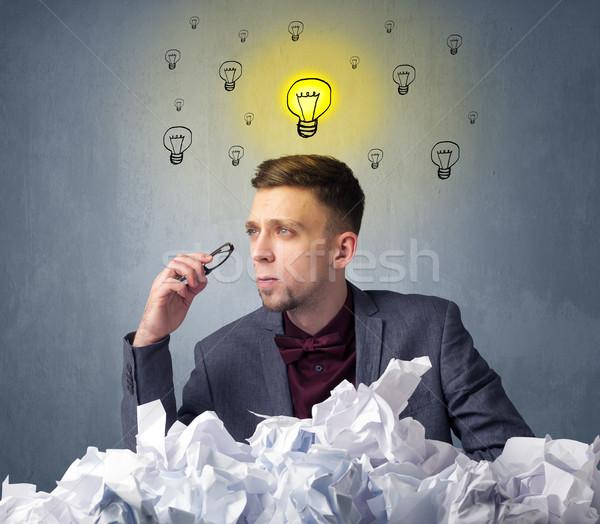 Empresário atrás papel jovem sessão acima Foto stock © ra2studio