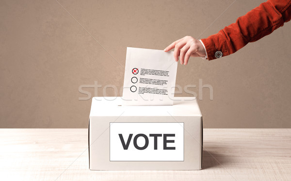 Közelkép férfi kéz szavazás szavazócédula doboz Stock fotó © ra2studio