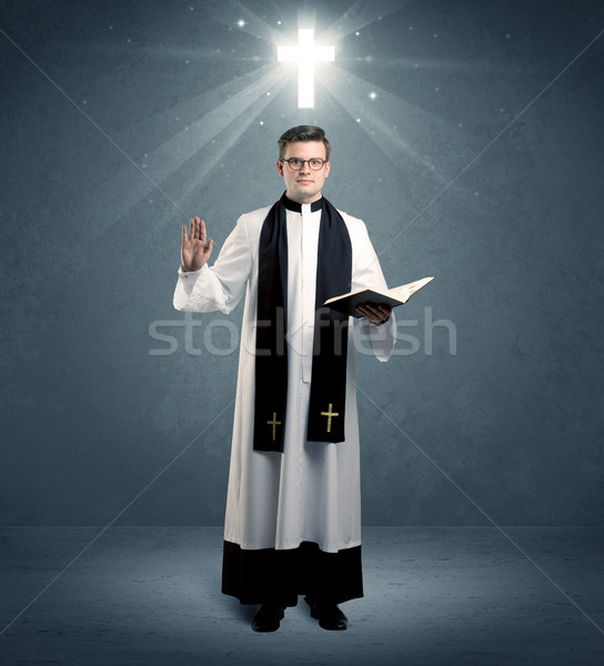 young priest in giving his blessing Stock photo © ra2studio