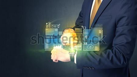 Man with smartwatch. Stock photo © ra2studio