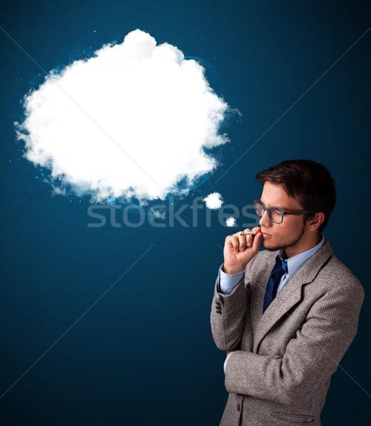 Młody człowiek palenia niezdrowy papierosów gęsty dymu Zdjęcia stock © ra2studio