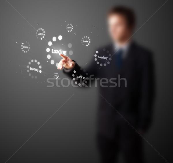 Businessman pressing simple type of start buttons Stock photo © ra2studio