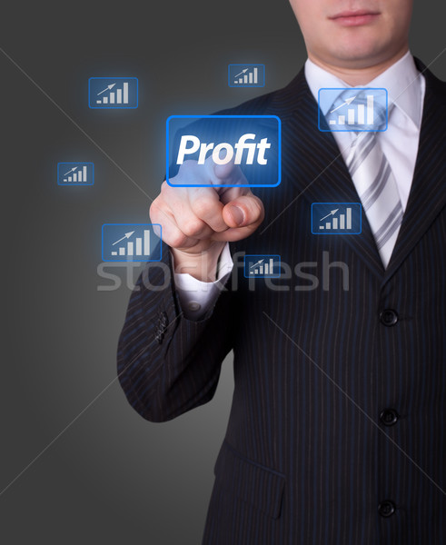 Man pressing profit button Stock photo © ra2studio